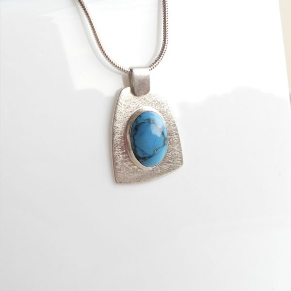 Silver pendant with turquoise cabachon