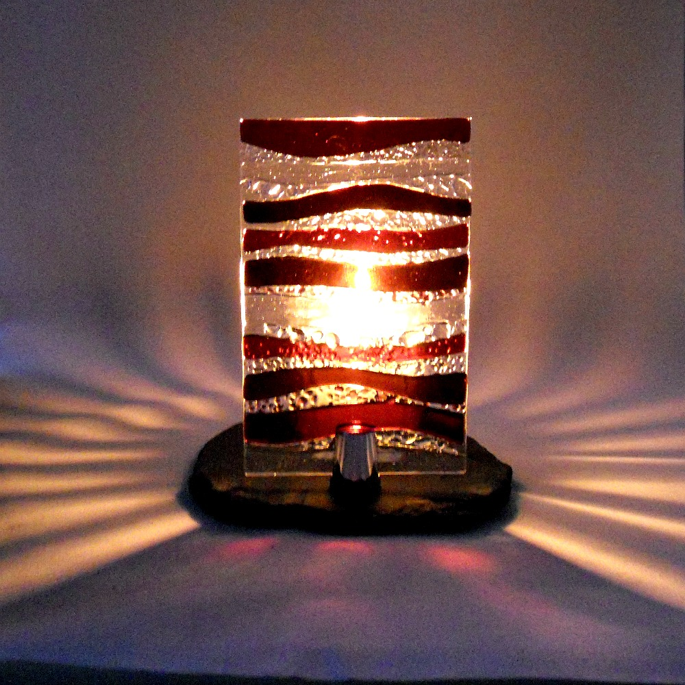 Dark Red Glass Candle Stand At Night