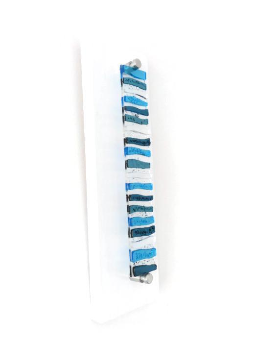 Glass art featuring blue wave pattern