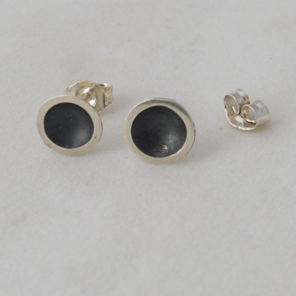 Silver and black ear studs