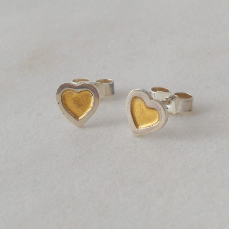 Silver hear shaped studs with gold leaf