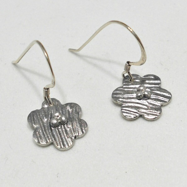 Earrings made with silver clay at workshop