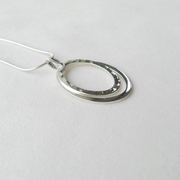 Silver oval pendant on snake chain