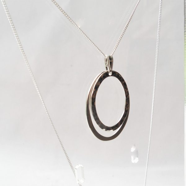 Oval pendant on curb chain